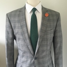 Use an accent color in your jacket or tie and match with the lapel pin (Lapel Pin and Necktie by Natty Neckware)